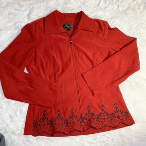Gorgeous red coat with black embroidery trim
